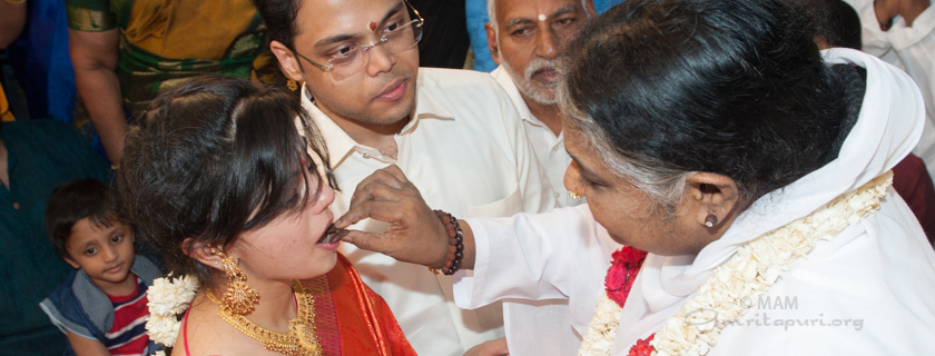 Amma giving darshan to a couple