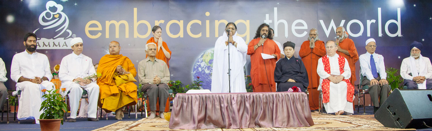Amma on stage during an Embracing the World function