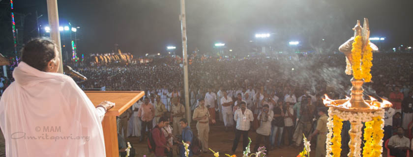 Amma addressing a crowd of people