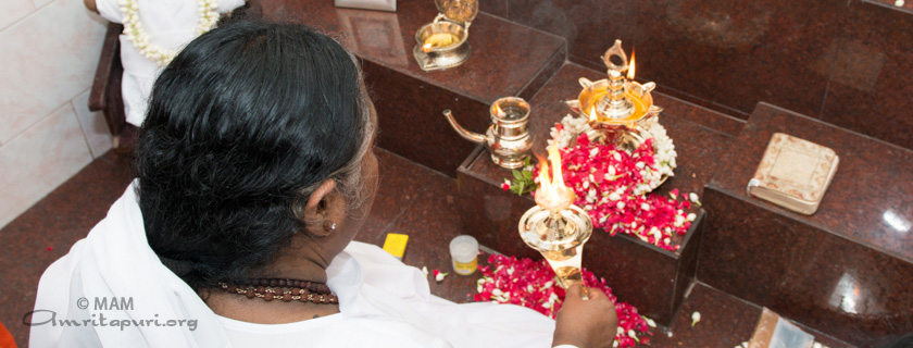 Amma performing puja