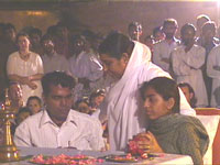 Amma consoling a girl whose mother and brother passed away in Gujarat earthquake