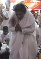 Amma bows down after darshan