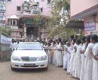Amma's car driving by the temple