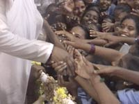 Amma with a group of orphans