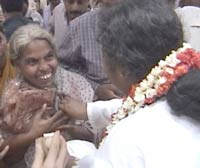 Amma distributes saris to widows