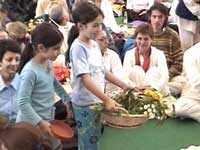 Little girls selling flowers