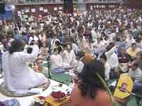 Amma leads the arati during the Atma Puja
