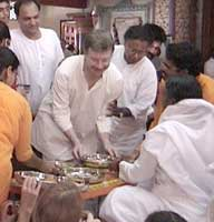 Amma serves food to devotees