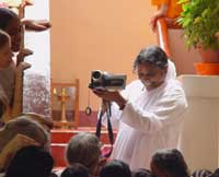 Amma filming the devotees