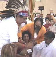 Native American Indian Chief gives eagle feather to Amma