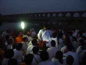 Amma with tour group by Godavari river at night