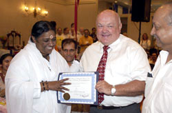 Amma with the mayor of Naperville, A. George Pradle