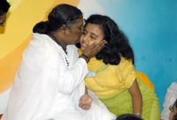 Amma giving darshan to medical student