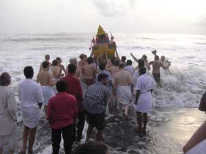 Ganesha statue being merged into the ocean