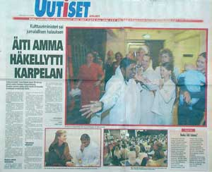 Finnish newspaper featuring Amma on page 1