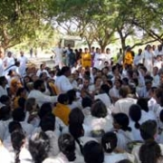 Amma with devotees on the roadside