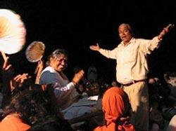 Devotee dancing for Amma