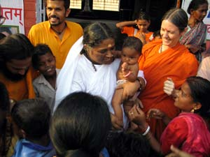 Amma holding a child