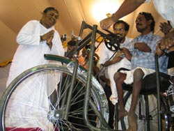 Amma gives away a wheelchair