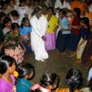 Amma dancing with children
