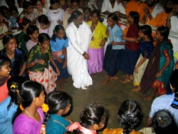Amma dancing with children