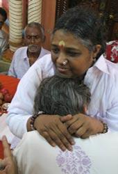 Amma wearing a devotee's shirt