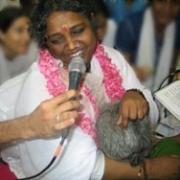 Amma singing during darshan