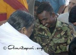 Amma giving darshan to a Sri Lankan  soldier