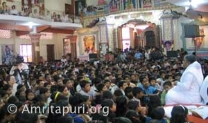 Amma with a large group of kids