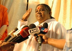 Amma being interviewed by the press