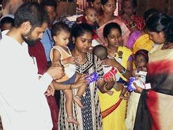 Dr chandra sekhar giving medicines to the mothers