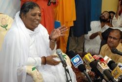 Amma talking to journalists in Amritapuri