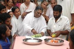 Amma preparing vegetables in the kitchen