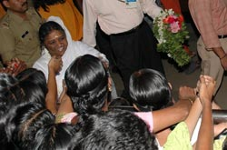 Amma with devotees at the airport