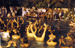 Amma swimming with the devotees