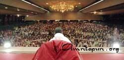 Amma speaking to the devotees in Amritapuri