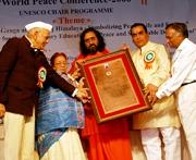 Swamiji accepting award on Amma's behalf