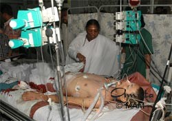 Amma visiting victims in the hospital
