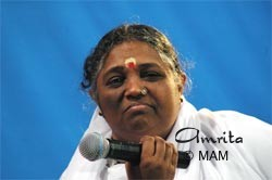 Amma holding a microphone