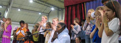 Amma on stage with children in Germany