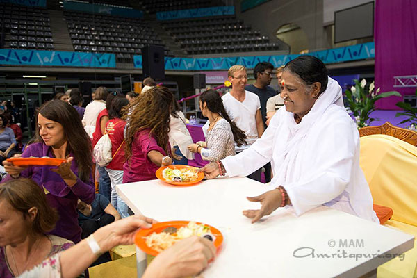 Image result for matha amritanandamayi with food
