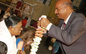 Sanjay Shrinet with Amma in London