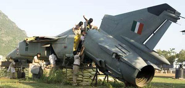 students climbing atop a MiG-23 aircraft